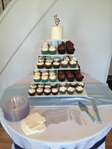 Can't decide on one flavor for your wedding reception? Go with an assortment of cupakes and a small topper to cut!