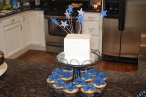 Cupcakes and smash cake for a baby shower! Or let us help with your gender reveal party!