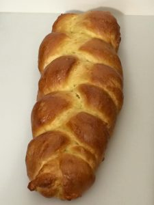 Holla for some challah! The large braided loaf is a beauty!